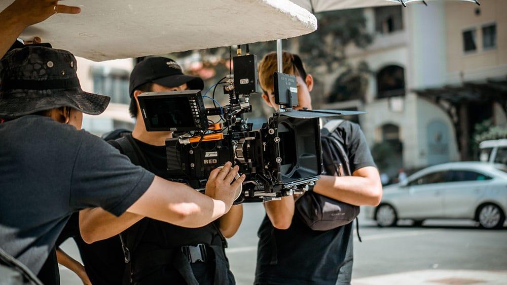 film crew around camera